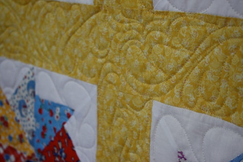 Quilting in the sashings.
