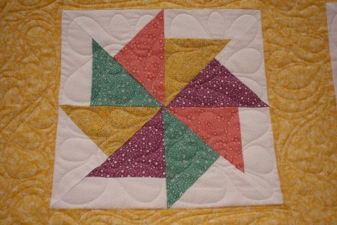 Close up of quilting in blocks.